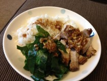Pork belly with dipping sauce sushi rice and greens